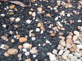 Tar and gravel fiberglass showing